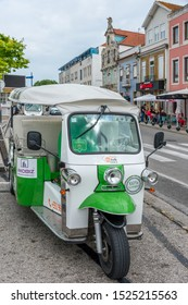Aveiro, Portugal - may 20, 2017: Tuc-tuc parked in front of the old buildings next to the Rossio garden in the historic city center