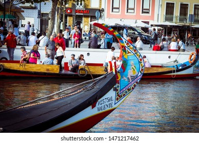 Aveiro, Portugal - October 1, 2016: Traditional boats on the canal in Aveiro, Portugal. Colorful boat rides in Aveiro are popular with tourists to enjoy views of the charming canals.
