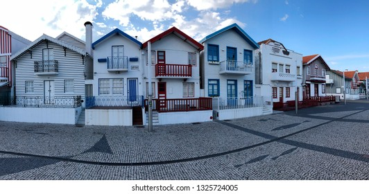AVEIRO, PORTUGAL - OCTOBER 20: Colorful typical houses in Costa Nova, Aveiro, Portugal on October 20, 2018. Costa Nova is the area of beaches in Aveiro, famous for its typical striped colorful houses.