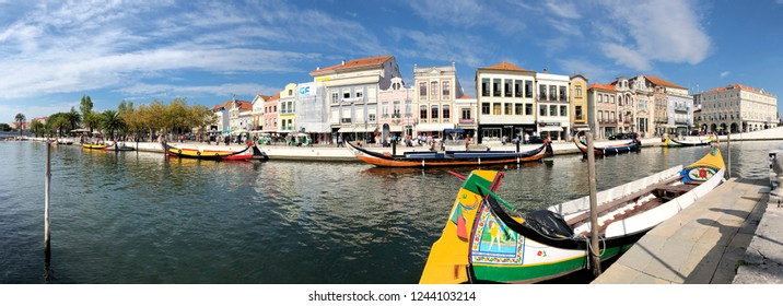 AVEIRO, PORTUGAL - OCTOBER 20: Moliceiro touristic boat service in Aveiro, Portugal on October 20, 2018. The Moliceiros are traditional boats that shows the city through the canals.