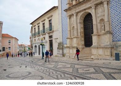 Aveiro, Portugal - Sep 3rd 2018: People walking in the city center of portuguese Aveiro along the famous Igreja da Misericordia de Aveiro Church. Aveiro is a popular tourist destination.