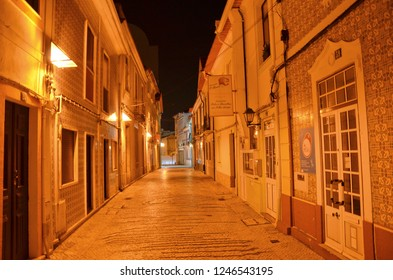 Aveiro, Portugal - Sep 3rd 2018: Empty narrow street in the old town of portuguese Aveiro taken at night. The city is a popular tourist destination and offers many beautiful attractions.