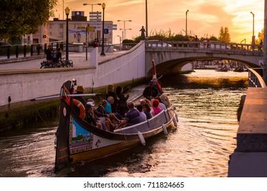 Aveiro, Portugal - September 01, 2017: Moliceiro boat strolling tourists through the ria of Aveiro, Portugal.