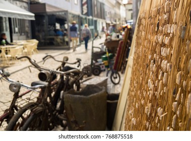 """AVEIRO, PORTUGAL - SEPTEMBER 24, 2017: streets and channel with boats. Aveiro is known as """"Portugal's Venice""""."""