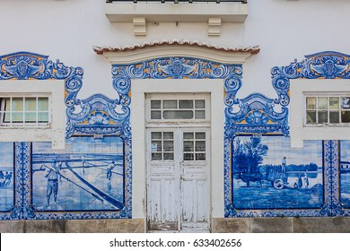 The Aveiro Railway station is Historic building ornamented with many typical blue Azulejos panels of Factory Fabrica da Fonte Nova displaying regional motifs. Portugal.