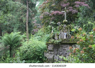 Aveleda, Europe/ Portugal, -June 5, 2018 - a beautiful green park with tall trees, a stone fountain, steps, benches, a well-groomed field of grass in an old manor of the 11th century, open to touris