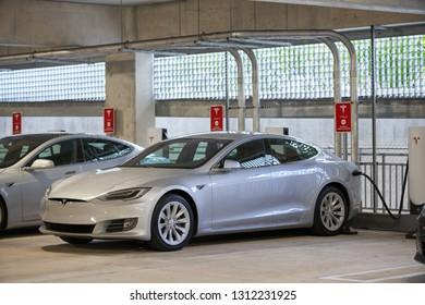 AVENTURA, FL, USA - FEBRUARY 11, 2019: Image of a Tesla Model S Supercharging at Aventura Mall