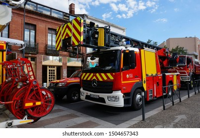 Avenue Charles de Gaulle, Albi, France - July 14, 2019 - Fire trucks including one with telescopic ladder, participating in Bastille Day military parade