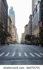 Avenue in New York City, early afternoon, pedestrians crossing the street
