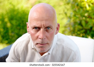 average age man looks spitefully camera