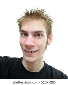 An average looking young adult smiles at the camera with slightly crooked teeth isolated on white background.