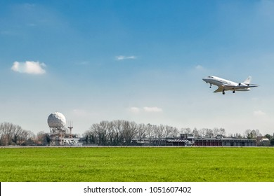 Aviation background, flight of airplane and ground control radar at the airport