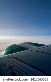 Aviation / February, 17th 2019: View over wing and engine of a new Embraer E190-E2 of Norwegian Widerøe's Flyveselskap on the flight from Helsinki to Berlin somewhere over the Baltic Sea