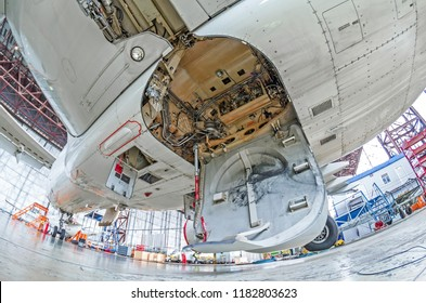 Aviation hangar with airplane, close-up landing gear of the airplane landing gear on maintenance repair