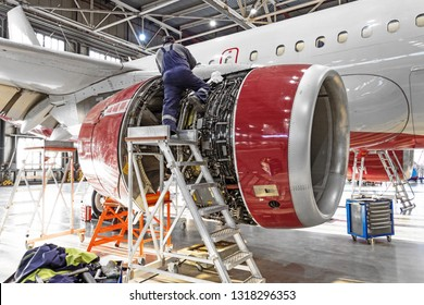 Aviation industry, mechanic repairs aircraft engine jet.