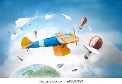 Aviator in drawn airplane. Mixed media