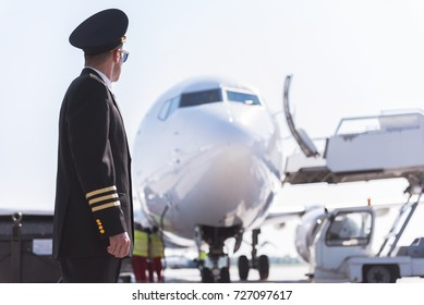 Aviator looking at big plane