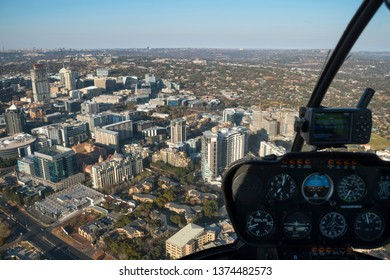 Aview of the Sandton business district seen from a helicopter cockpit