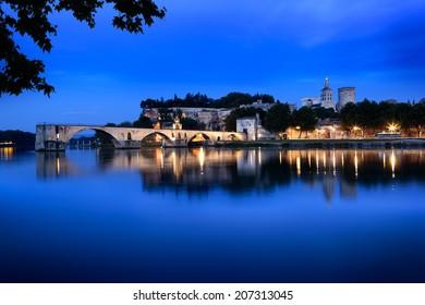 Avignon Bridge, France, viewed at night.  With the Papal Palace.