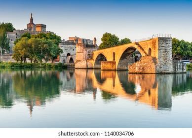 Avignon Bridge with Popes Palace and Rhone River at sunrise, Pont Saint-Benezet, Provence, France.