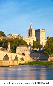 Avignon Bridge with Popes Palace and Rhone river at sunset, Pont Saint-Benezet, Provence, France