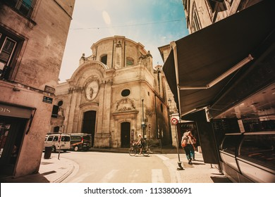 Avignon, FRANCE, 18 June 2018: Saint Agricol street and Chapel of the Oratory in Avignon
