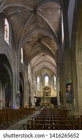AVIGNON, FRANCE - APRIL 22, 2019: Nave of Saint-Agricol Collegiate Church. The Gothic Saint-Agricol Collegiate Church of Avignon is a church built in the 7th century.