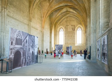 Avignon, France - August 25, 2016:  Visitors in the inside halls  of the Palace of the Popes