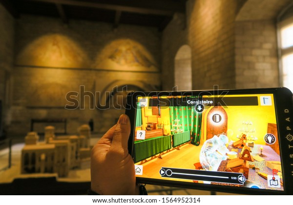 Avignon, France - Janvier 2019: Smart tablets reconstruct virtual reality of historical monuments