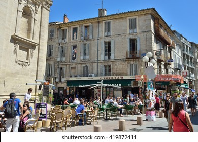 AVIGNON, FRANCE - JUL 12, 2014: Street scene in historical centre of Avignon. Avignon is a famous and very popular among tourists city in Provence in south of France.