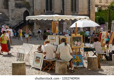 Avignon France July 13th 2015 : Local artists offering artwork for sale outside the Palais du Papes in Avignon, France