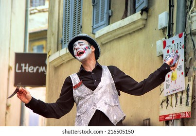 AVIGNON, FRANCE - JULY 19, 2014: Actor on stilts advertising his performance during famous theatre festival from July 4 to 27, 2014 in Avignon, south of France.