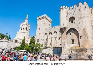 Avignon, France - July 24, 2011: Palais Des Papes, Front Square full of people in Avignon. Before Vatican, Avignon was the seat of the Pope and across the river, at Villenueve, was the Cardinal's.