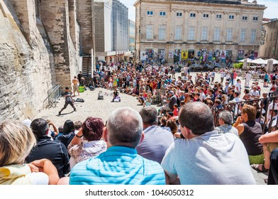 Avignon, France - July 24, 2011: Avignon, Palais Des Papes, Front Square, people watching arstists show during the Avignon Art Festival Off. Before Vatican, Avignon was the seat of the Pope