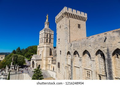 AVIGNON, FRANCE - JUNE 12, 2016:  Christian cross in front of Cathedral and Papal palace in Avignon in a beautiful summer day, France
