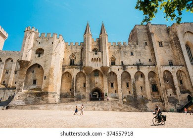 Avignon, France - June 27, 2015: People walking near ancient Popes Palace, Saint-Benezet, Avignon, Provence, France. Famous landmark