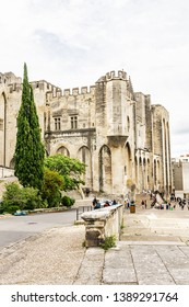 AVIGNON, FRANCE - JUNE 6, 2016: Most famous square in Avignon is called Place du Palais des Papes with main attraction - Avignon Papal palace (Palais des Papes, 1364).