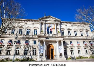 AVIGNON, FRANCE - MARCH, 2018: Hotel de Ville and the Clock Tower Square Avignon France