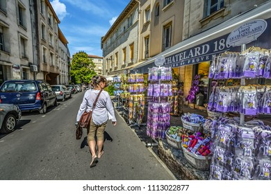 Avignon, France - September 22 2016: A young woman walks past a gift shop selling lavender products in the city of Avignon, France, in the Provence region