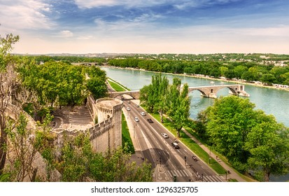 Avignon, France - September 4, 2016: Panorama of Avignon with the Rhone River and the Saint-Benezet Bridge from the Rocher de Dom Park.