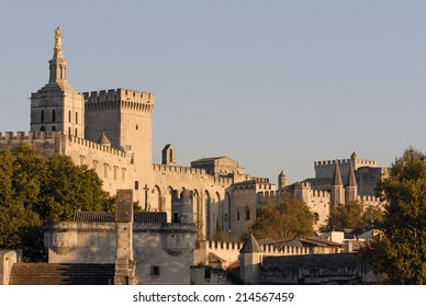 AVIGNON, FRANCE-APRIL 01, 2005: the gothic architecture of the Popes Palace seen at the sunset, in Avignon.