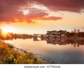 Avignon old bridge against colorful sunset in Provence, France