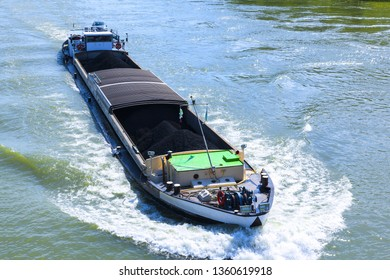 Avignon, Rhone River, , France: A Barge transports coal on the Rhone.
