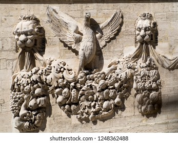 Avignon/France - August 10 2016: Medieval crest on a building in the Place du Palais square in Avignon, France. Avignon is a commune in south-eastern France in the department of Vaucluse.