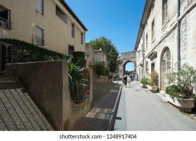 Avignon/France - August 10 2016: Rue Ferruce street, in Avignon, France. Avignon is a city in south-eastern France in the department of Vaucluse on the left bank of the Rhône river.