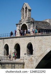 Avignon/France - August 10 2016: Saint Nicholas Chapel at the Pont Saint-Bénézet. The Pont Saint-Bénézet, also known as the Pont d'Avignon, is a famous medieval bridge in the town of Avignon.