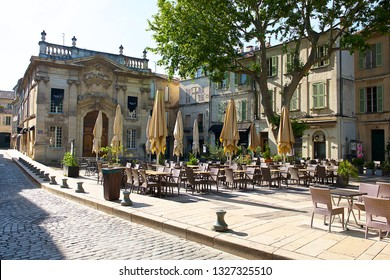 Avignon,France-06 21 2015:Tables of a café on a terrace along a street in the old town of Avignon,south France.
