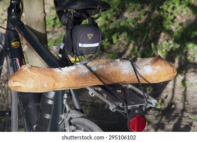 avignon,france-july 3, 2015: Taking the bike in the morning to get a french baguette in avignon France