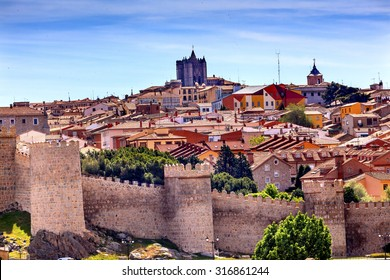 Avila Ancient Medieval City Walls Castle Swallows Castile Spain.  Avila is described as the most 16th century town in Spain.  Walls created in 1088 after Christians conquer the city from the Moors