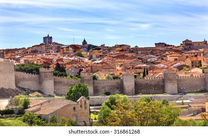 Avila Ancient Medieval City Walls Castle Swallows Castile Spain.  Avila is described as the most 16th century town in Spain.  Walls created in 1088 after Christians conquer the Moors